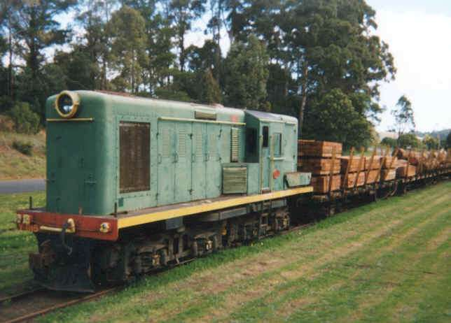1115 sits in Pemberton yard with new sleepers from the sawmill for the railway and logs to be pushed into the Mill